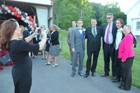 Chaperone takes photo of students posing with other chaperones