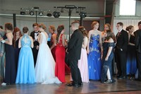 far away shot of students socializing inside prom event