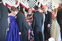 students talk inside prom