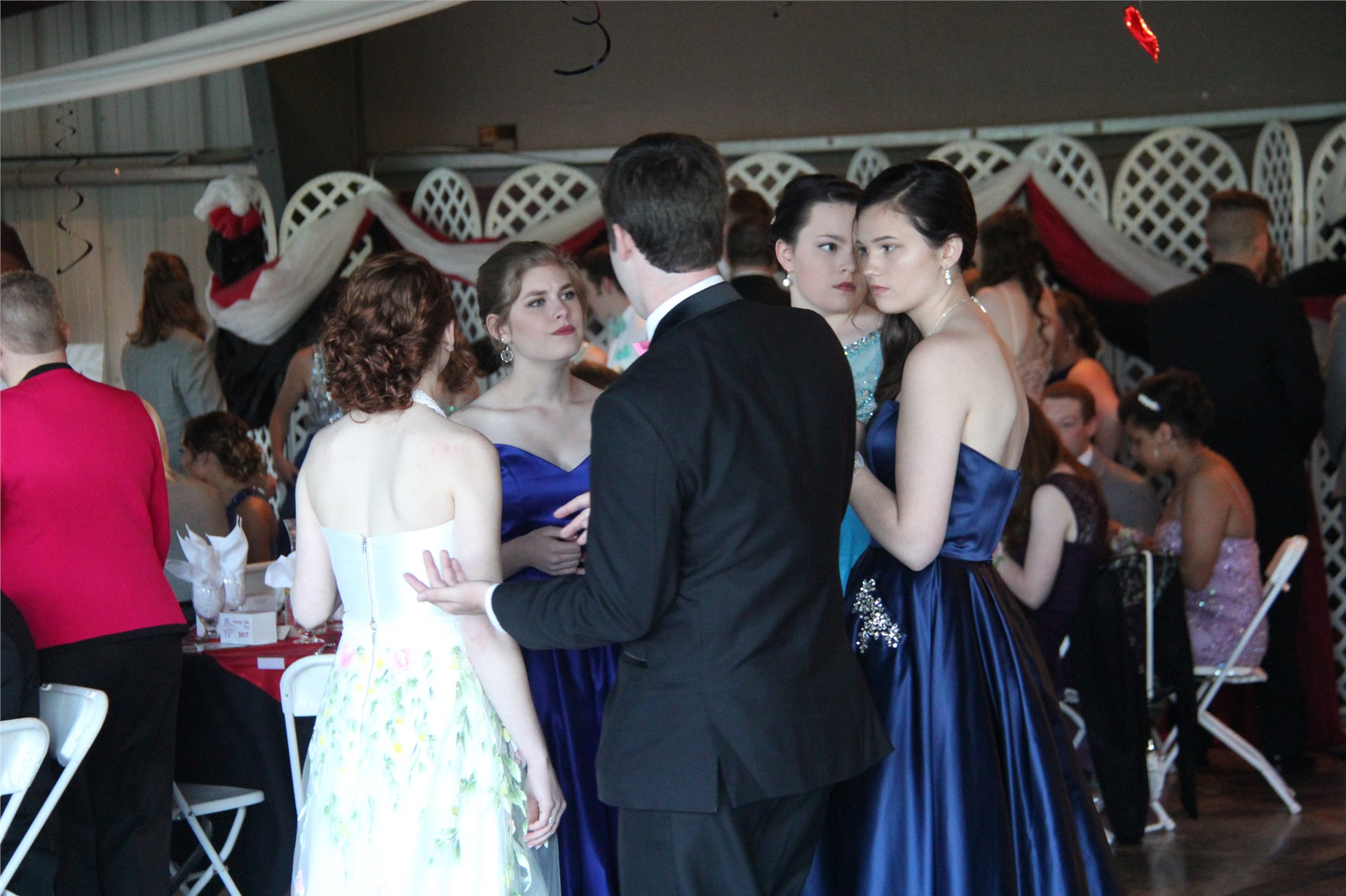 group of students socialize inside prom event