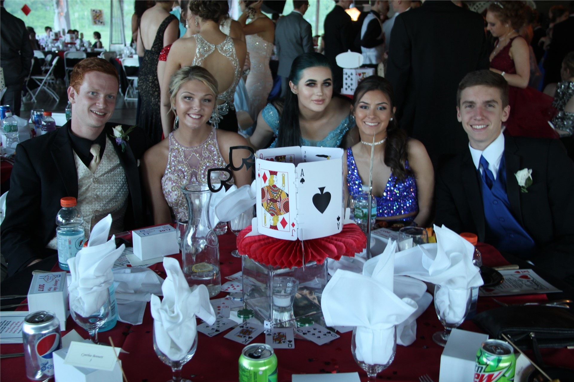 students pose for a picture at table