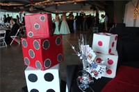 dice decorations with students socializing in the background