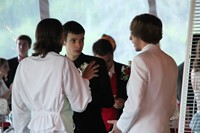 group of male students socialize at the prom