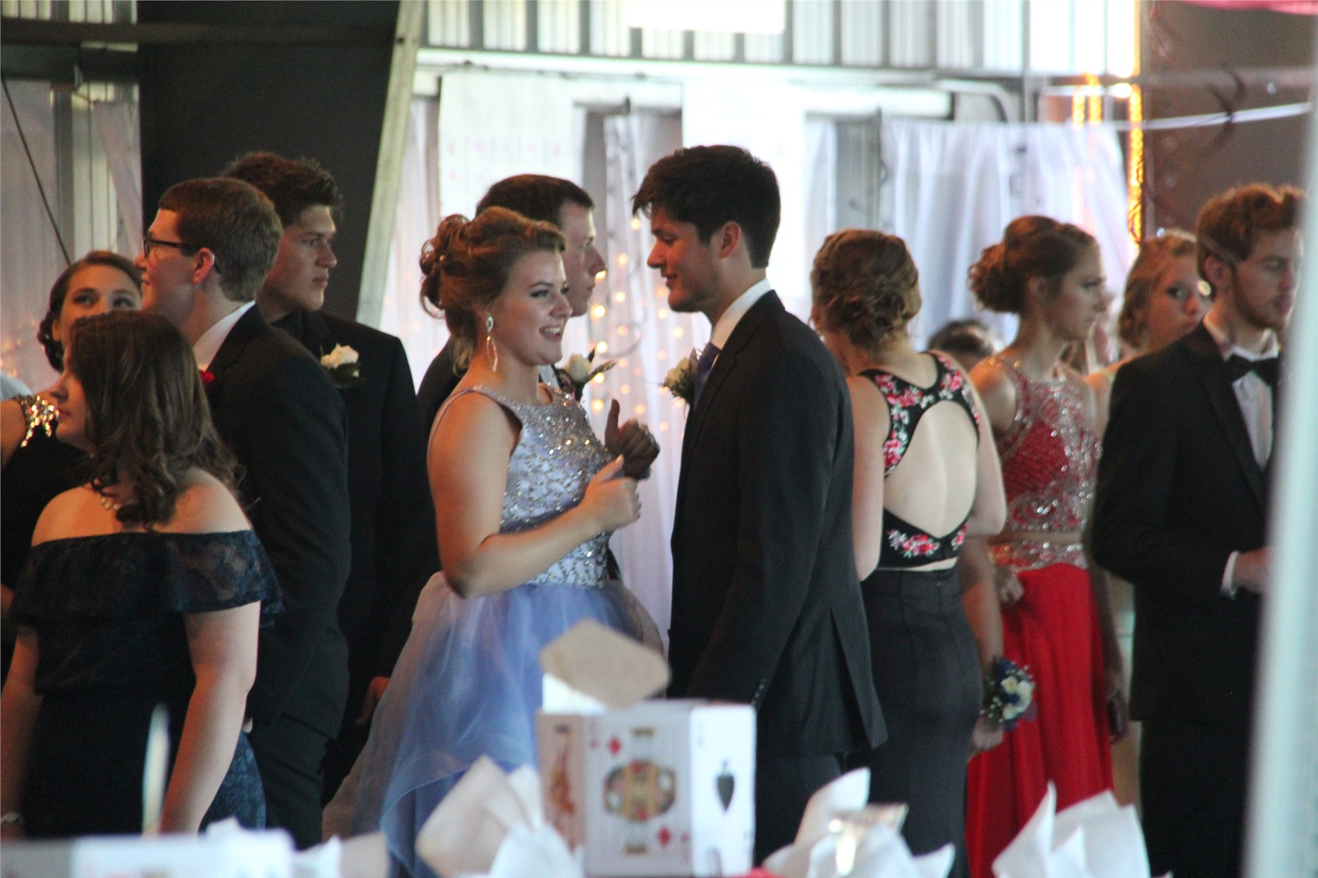 distance shot of group of students talking at prom event