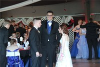 group of students socializing inside prom venue