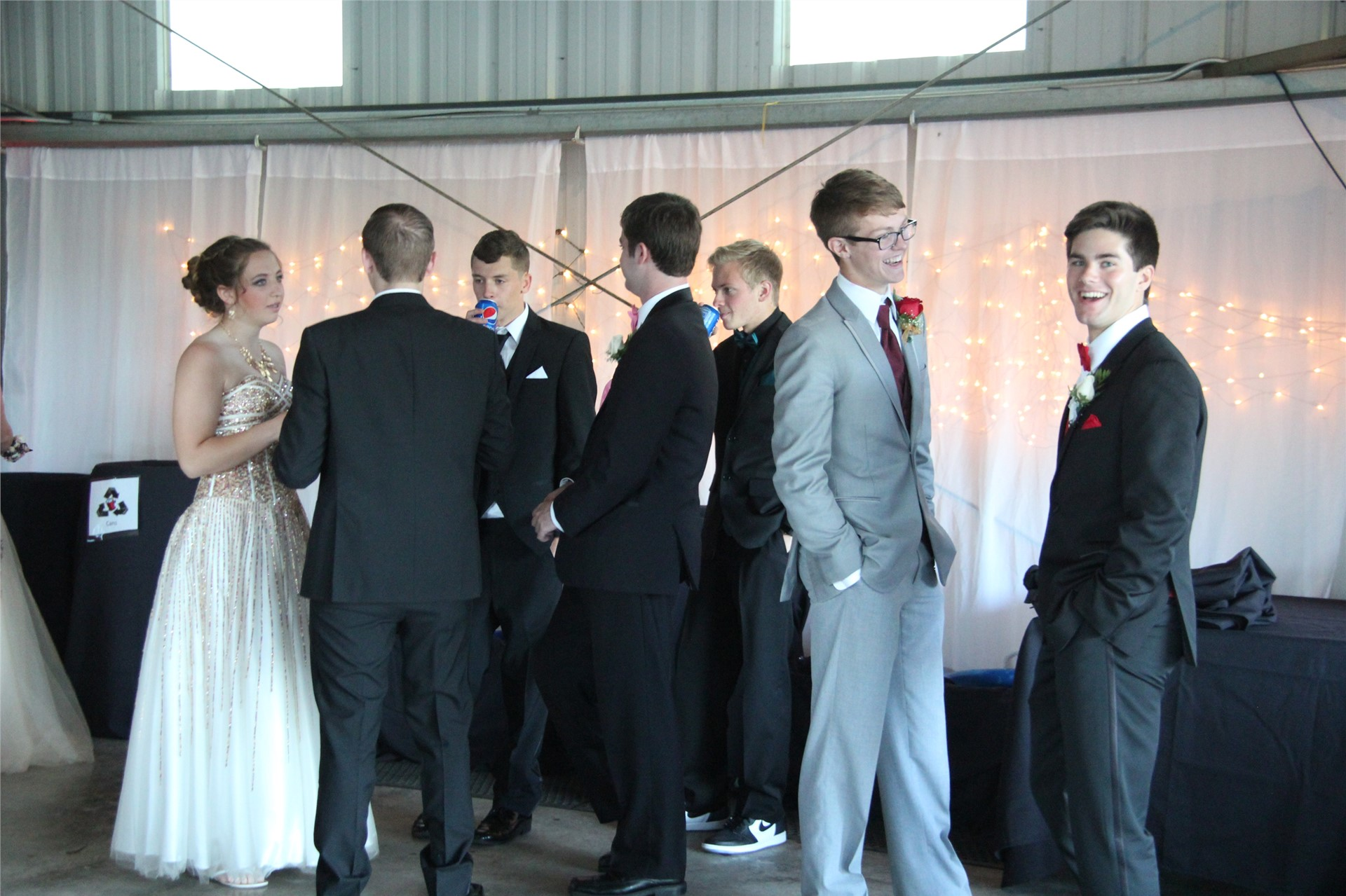 group of students socialize inside prom venue