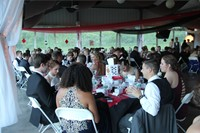 students sitting and socializing inside prom venue