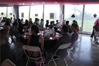 students sit and socialize inside prom venue