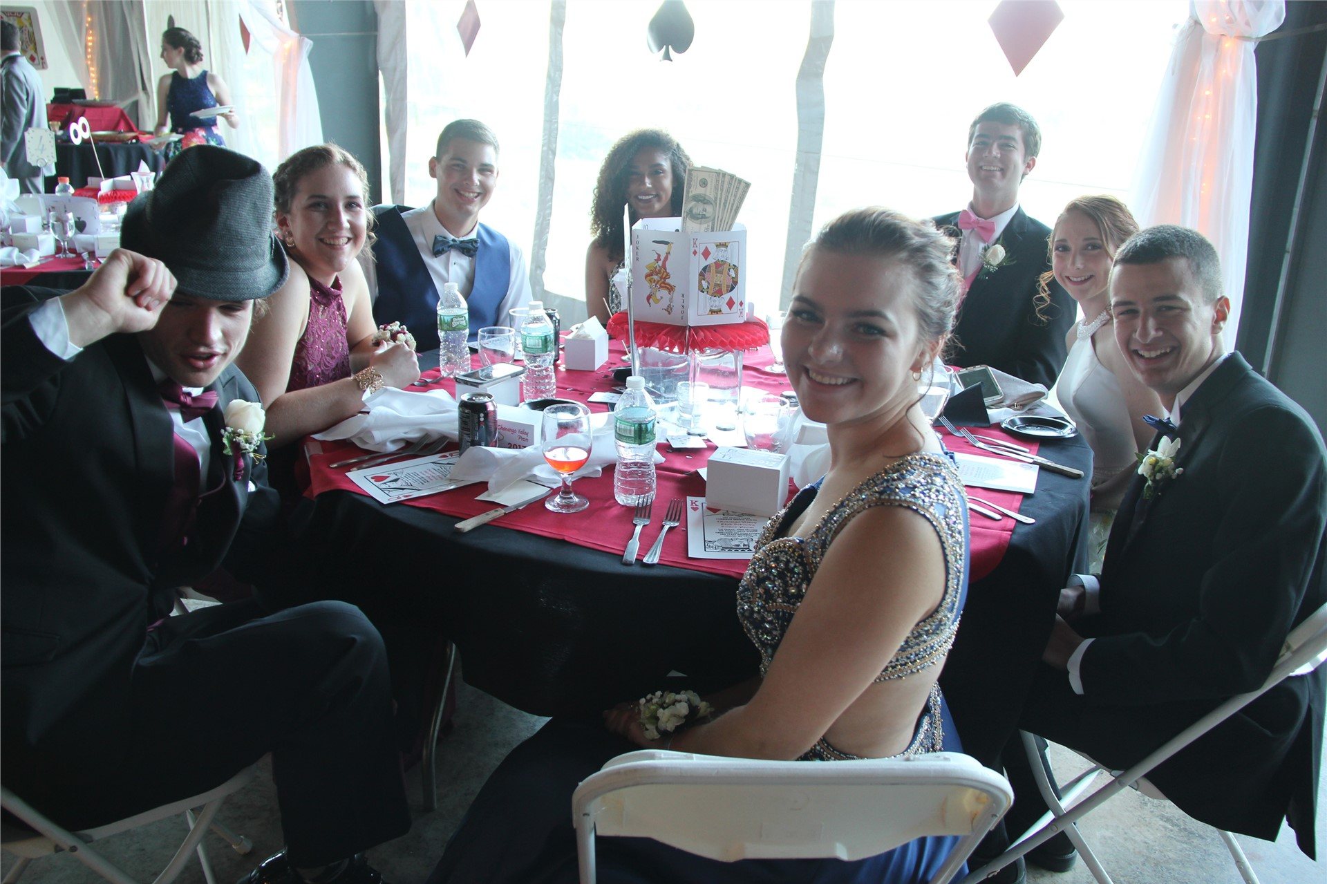 table of students pose sitting for a photo