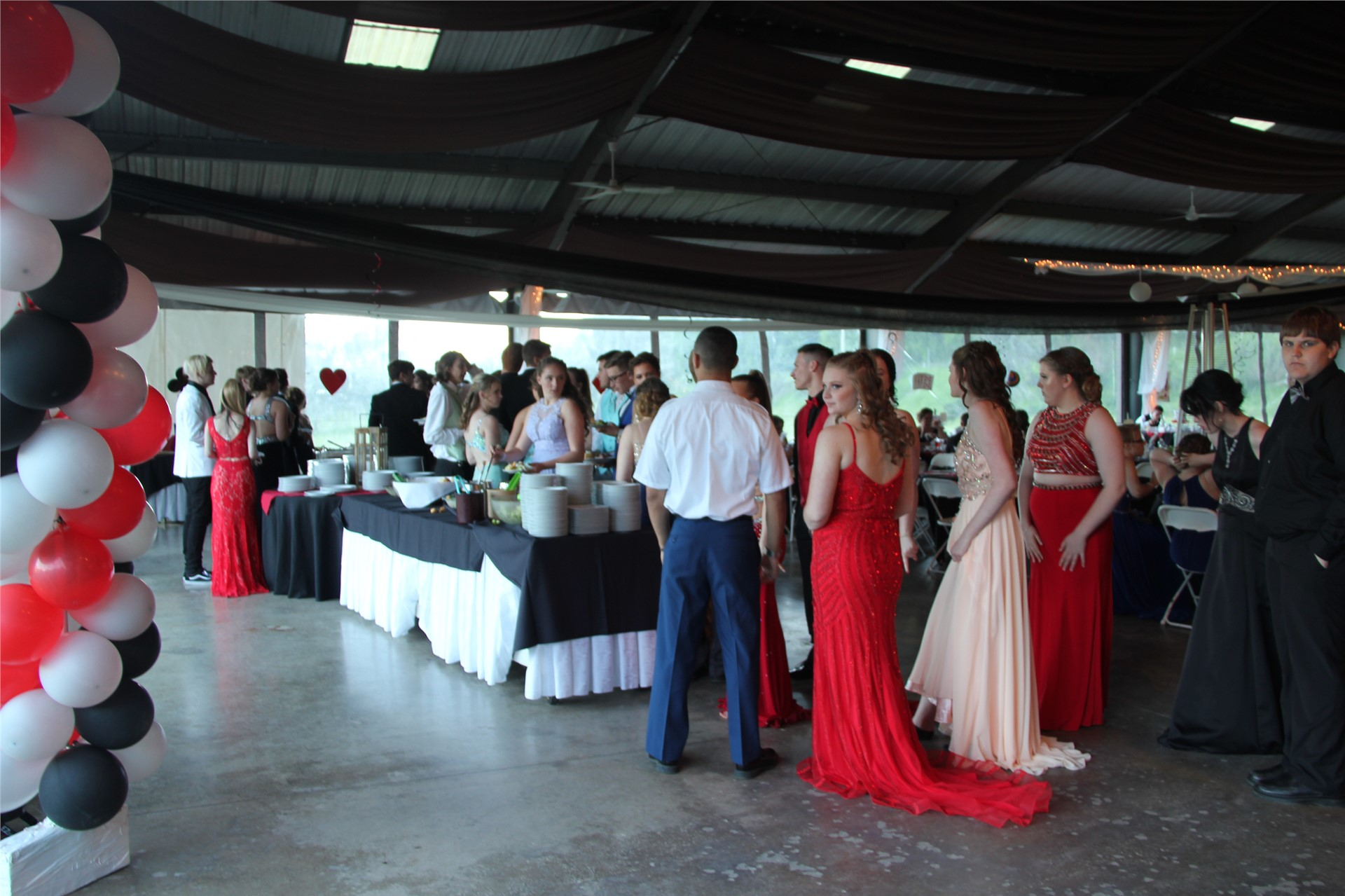 far away shot of students inside of prom venue