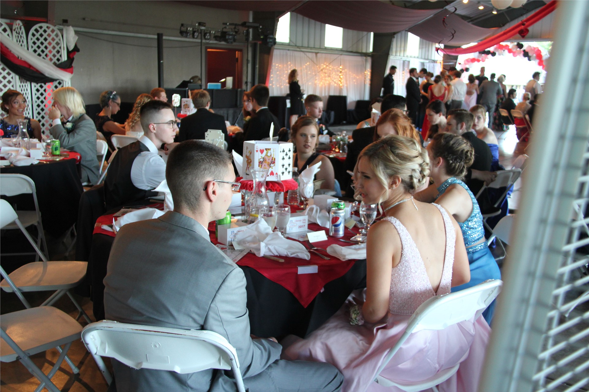 students sit and socialize inside of prom venue