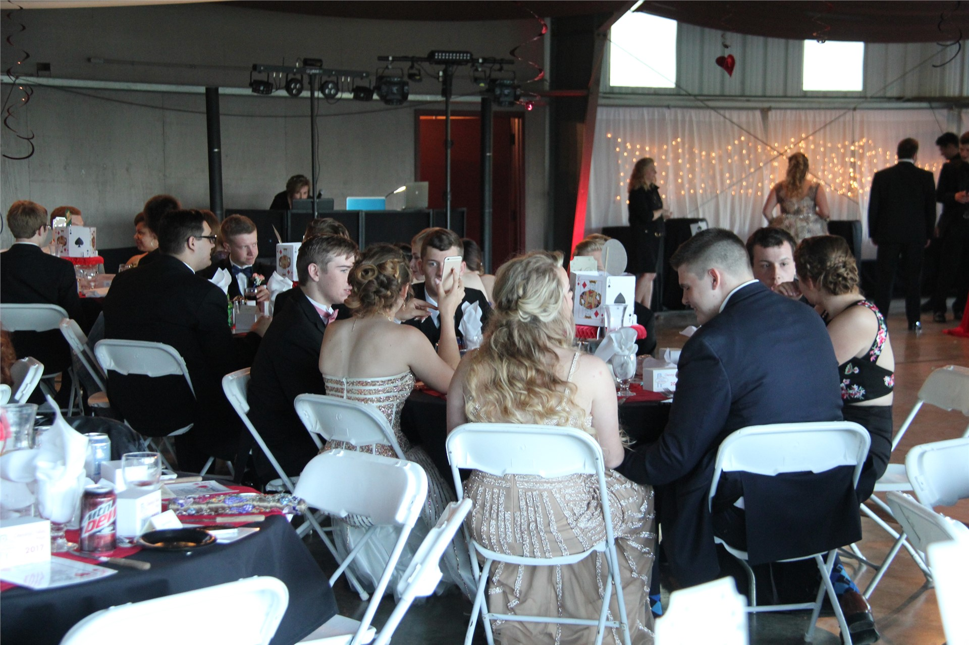 students sit and socialize at prom event