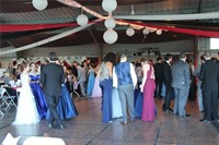 far away shot of students socializing at prom