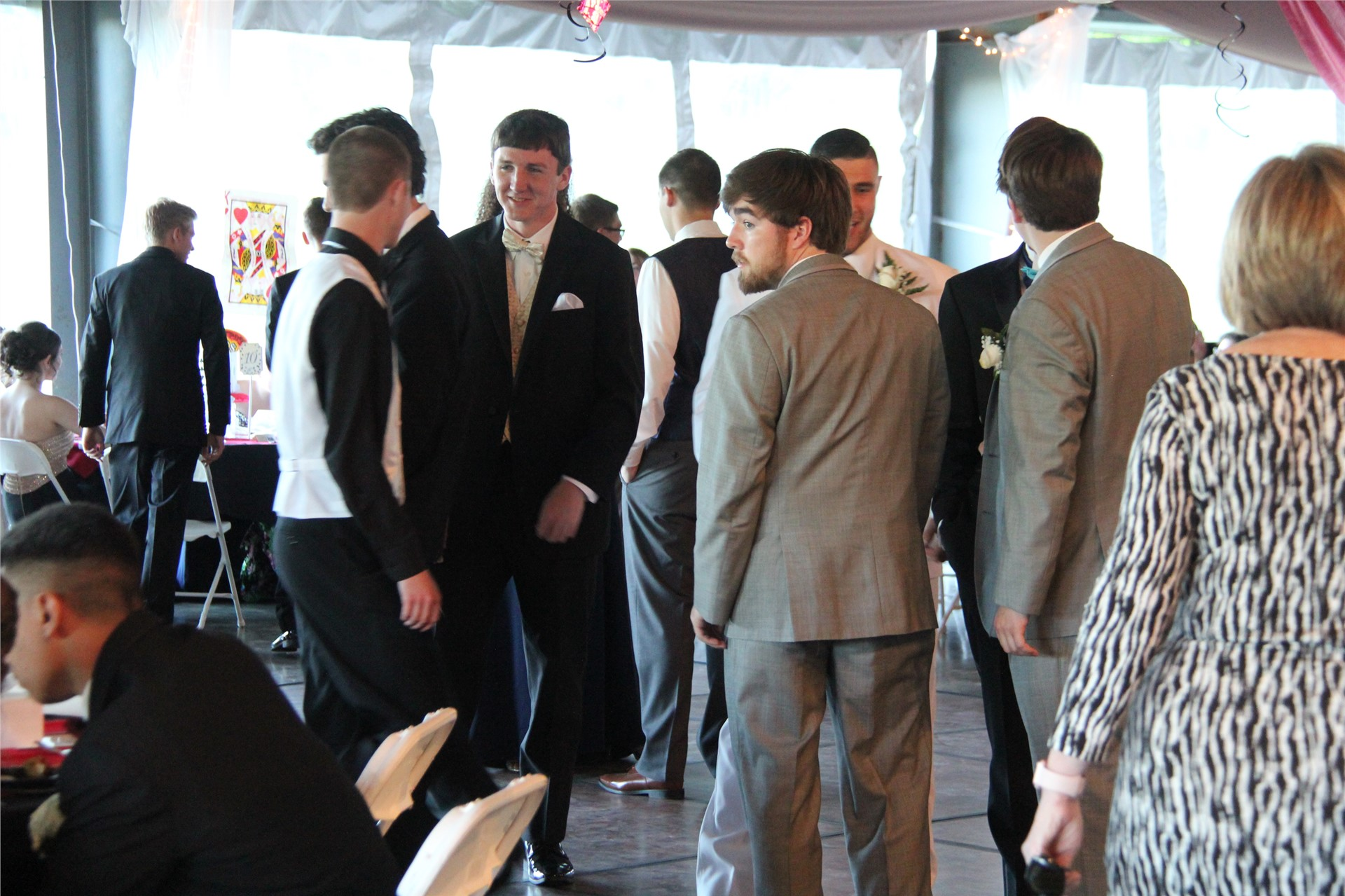 group of students socialize at prom event