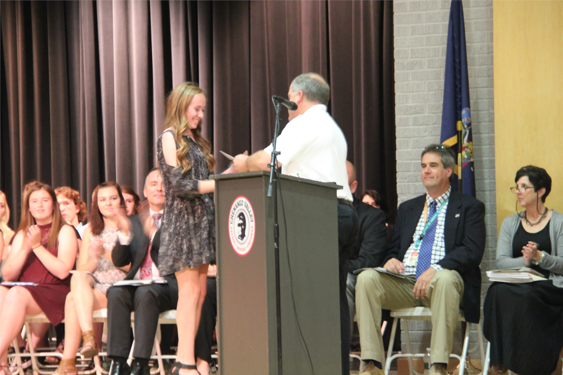 female student receives award from man