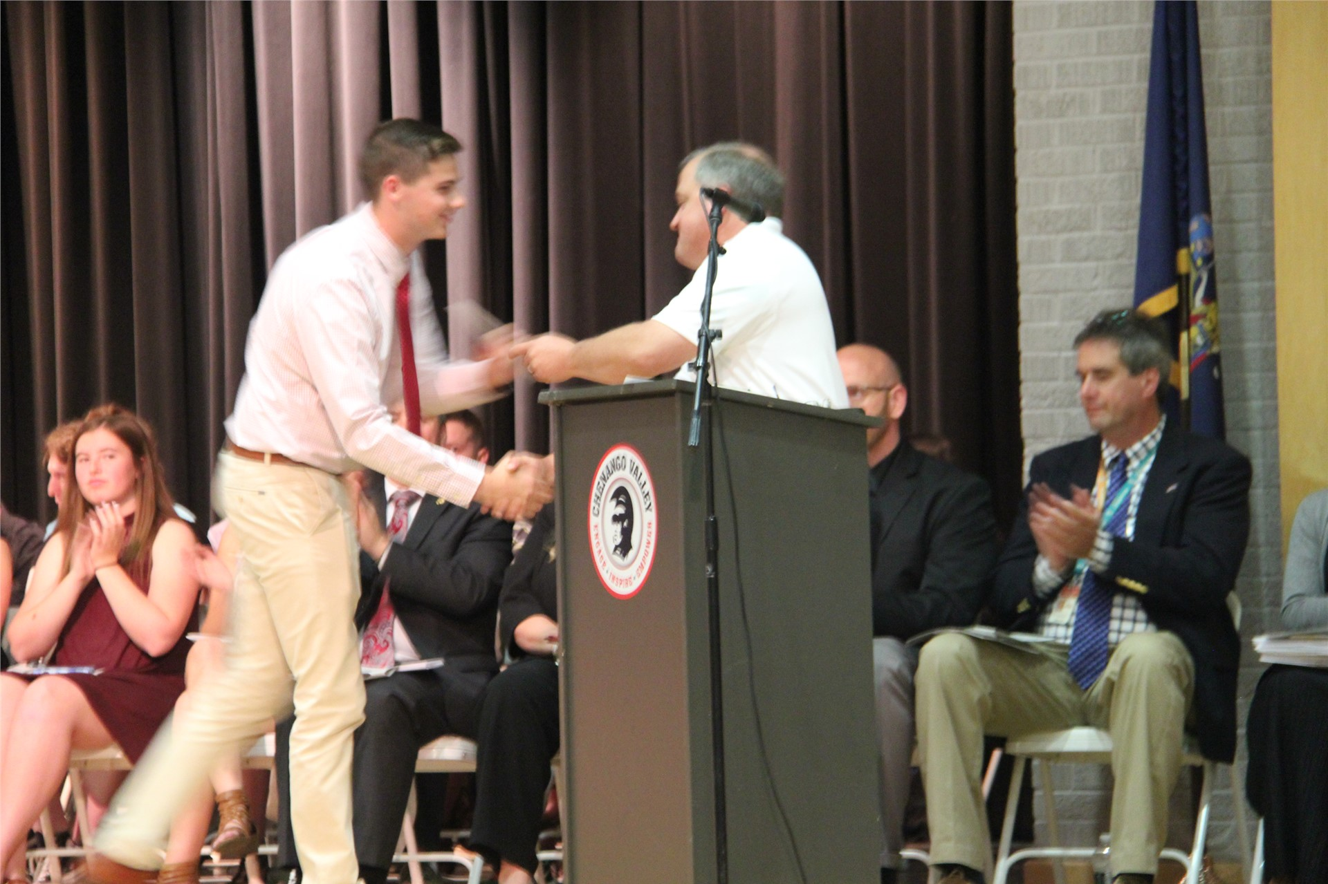male student accepts award from man