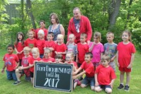 elementary school class poses behind a port dickinson field day 2017 sign