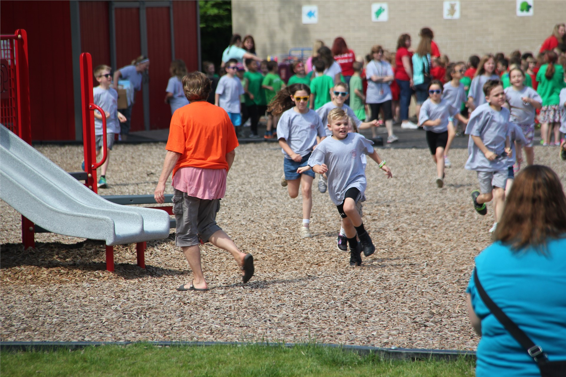 excited students run outside to field day