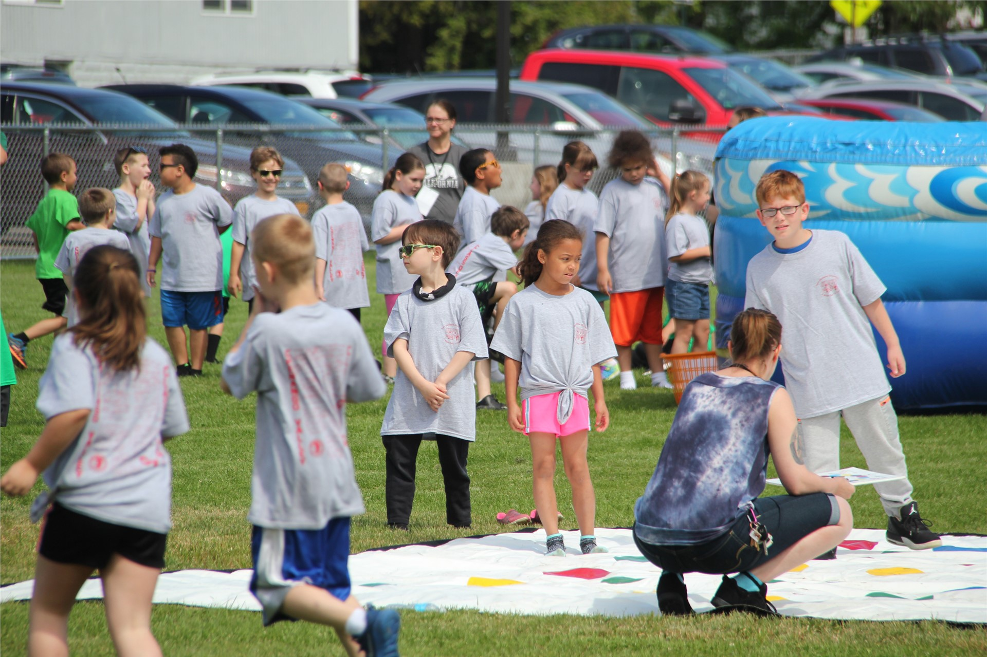 far shot of children playing twister and standing