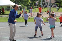 teacher and students dance outside