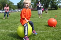 young boy bounces on ball