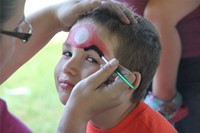 boy gets face painting like mario character
