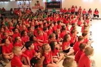 elementary students watch talent show in audience