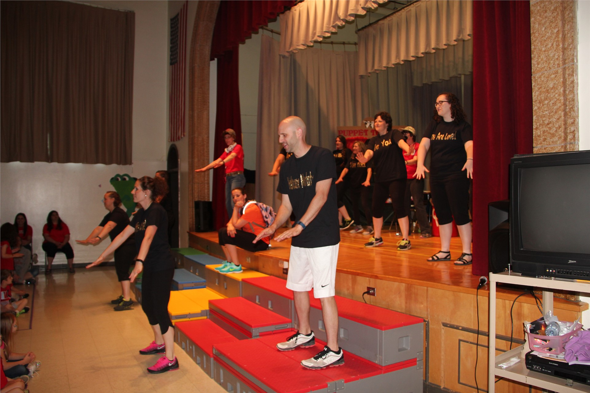teachers on stage dance in talent show 2