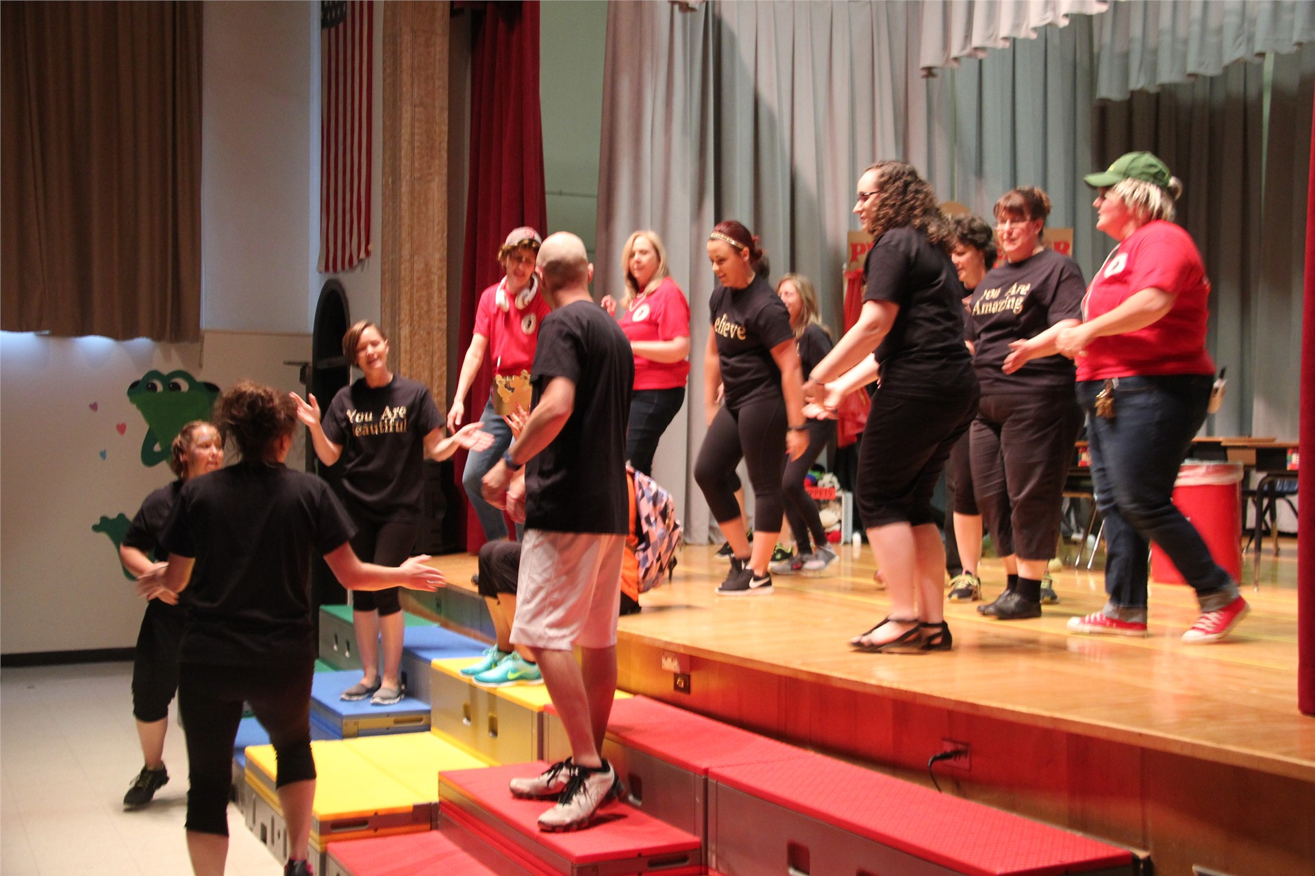 teachers on stage dance in talent show.