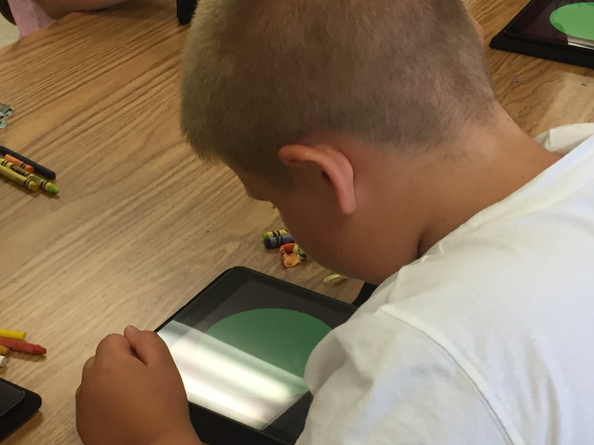 boy summer steam student looks at iPAd to learn about colors