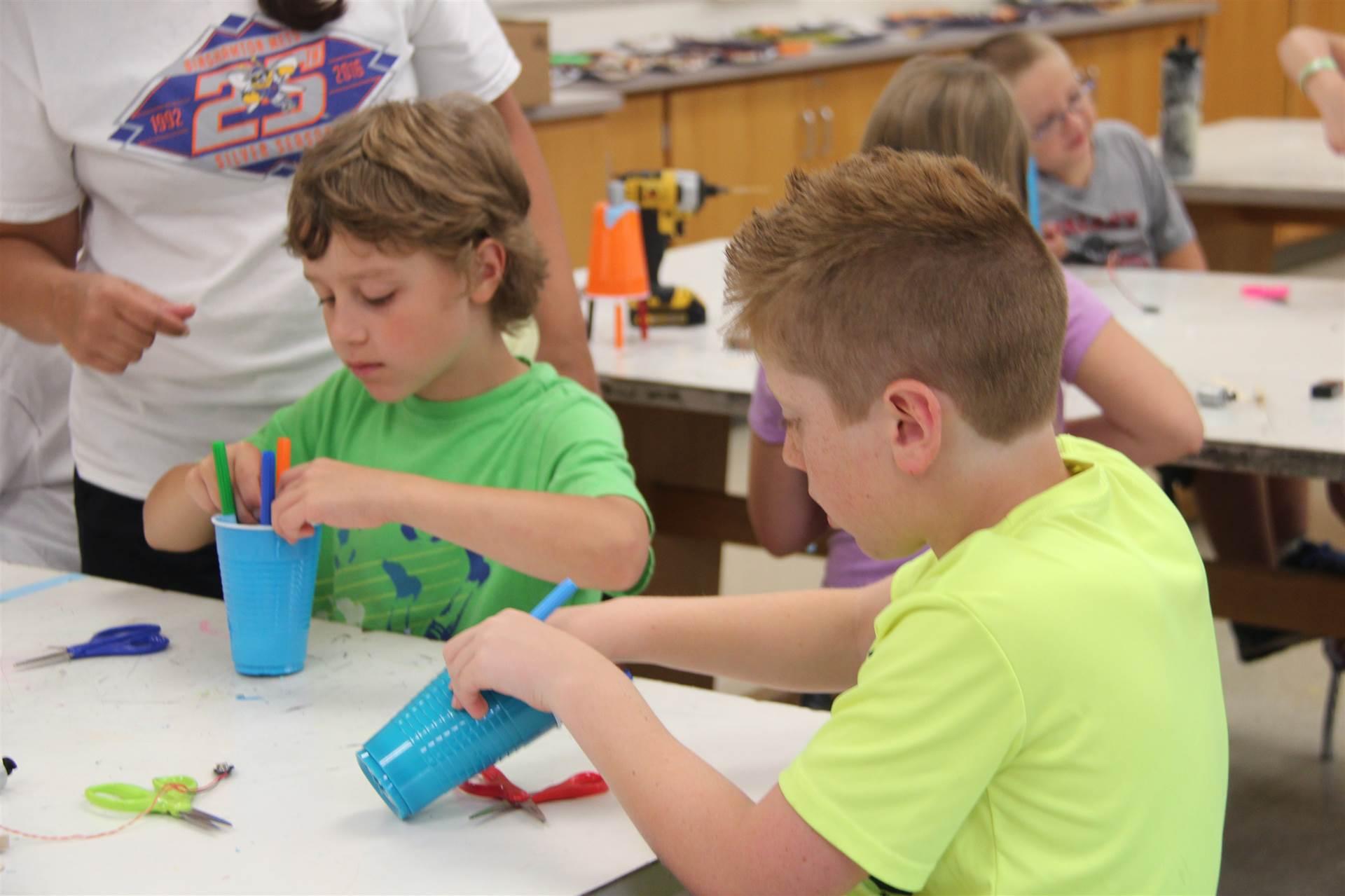 boys working on robots in c v summer steam program