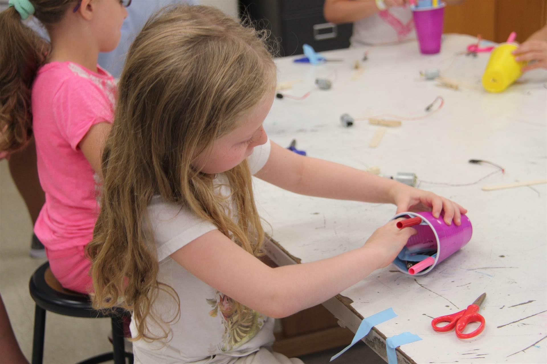 girl working on robot in c v summer steam program