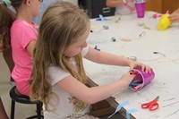 girl working on robot in c v summer steam program