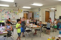students working on three little pigs houses challenge houses wide shot of classroom