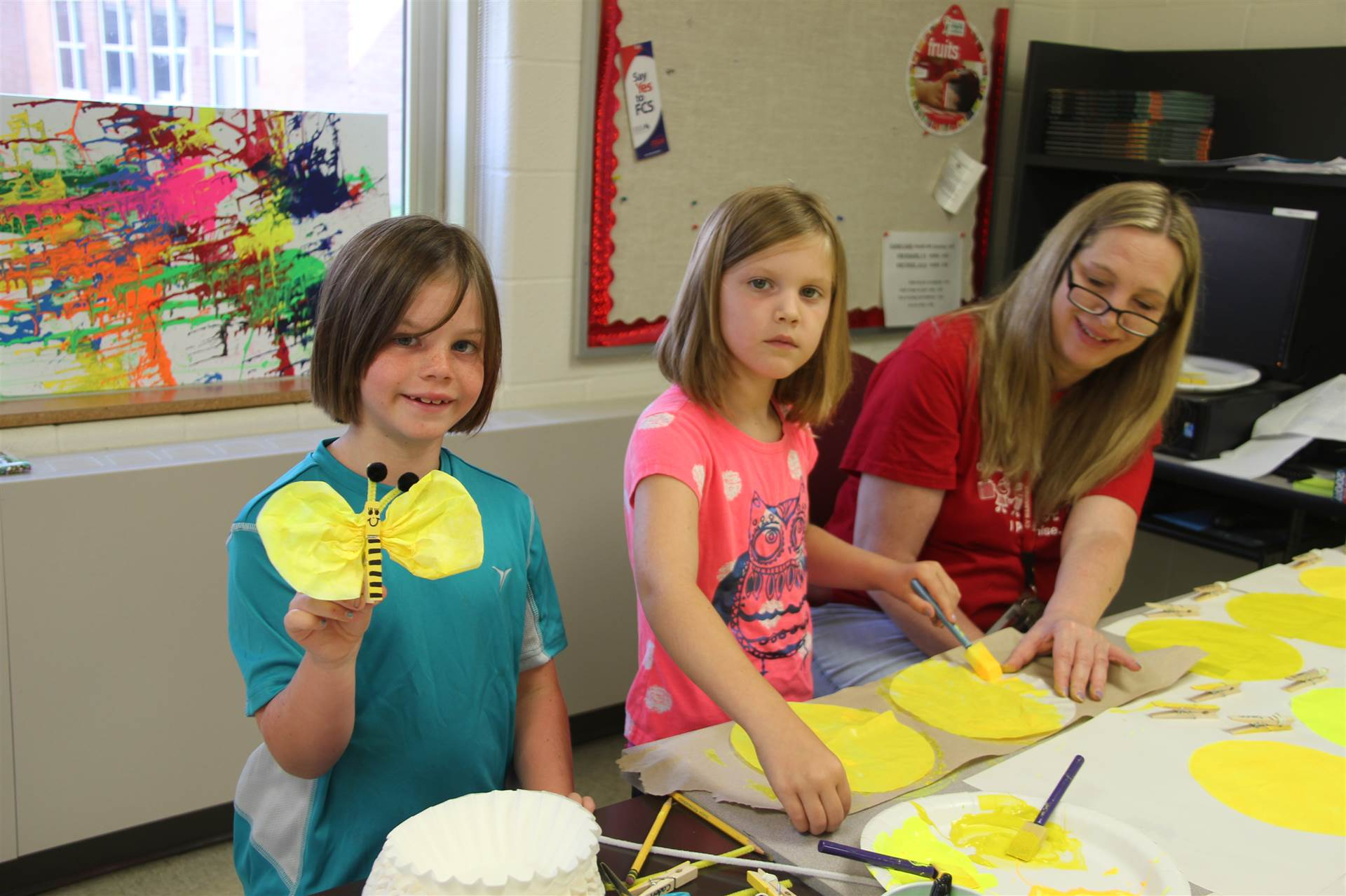 summer steam students working on bee art projects