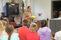 chris mckinney shows students yellow wool