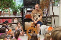 chris mckinney shows summer steam students how wool is spun