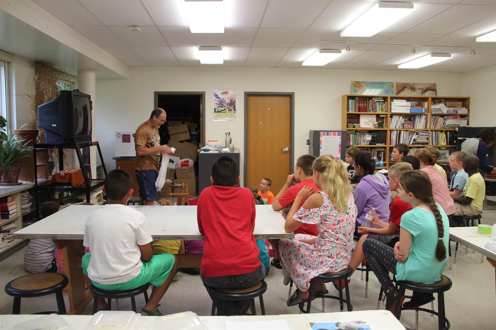 chris mckinney talks to students about alpaca wool