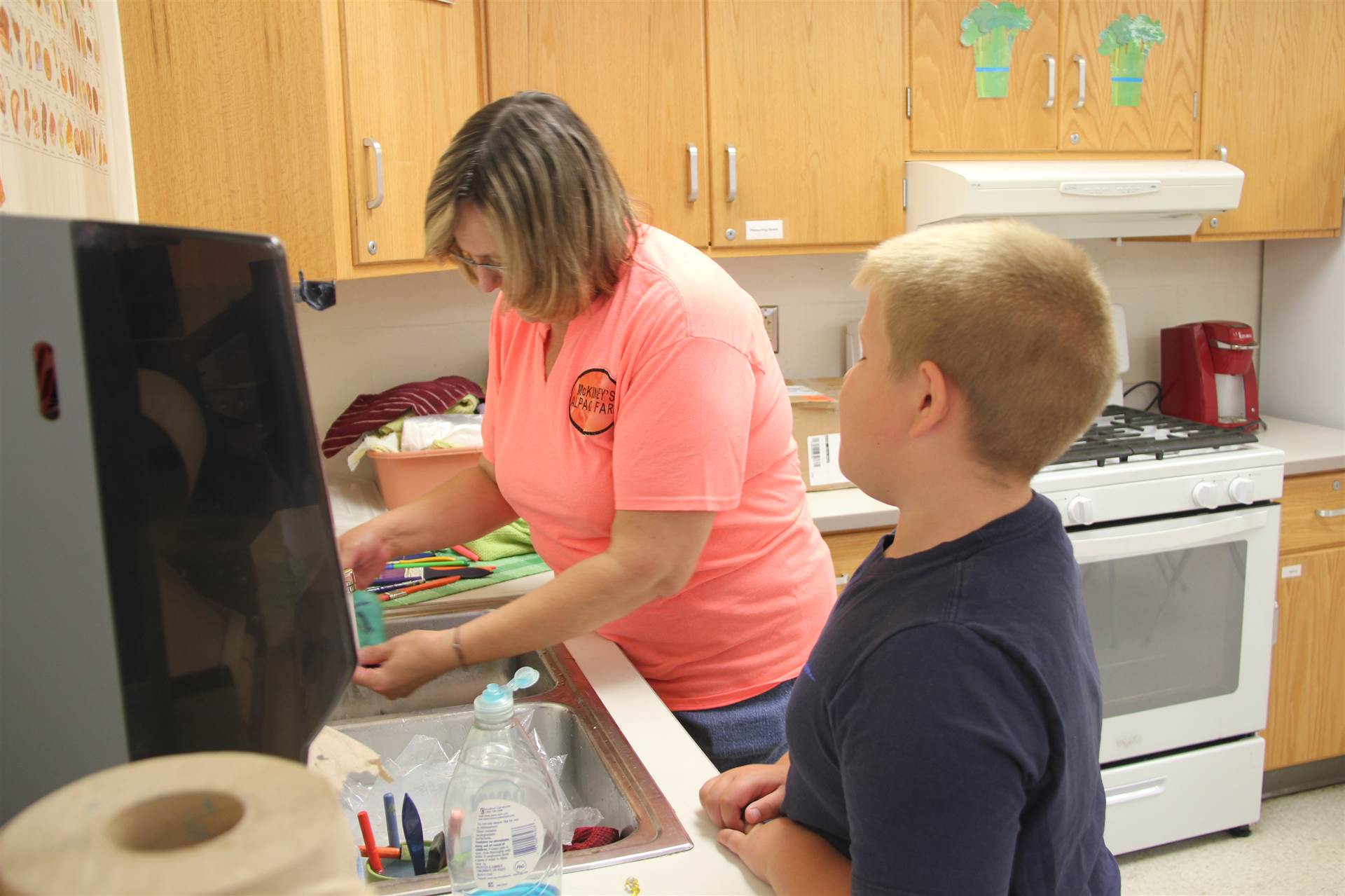 kris mckinney washes felt project for student