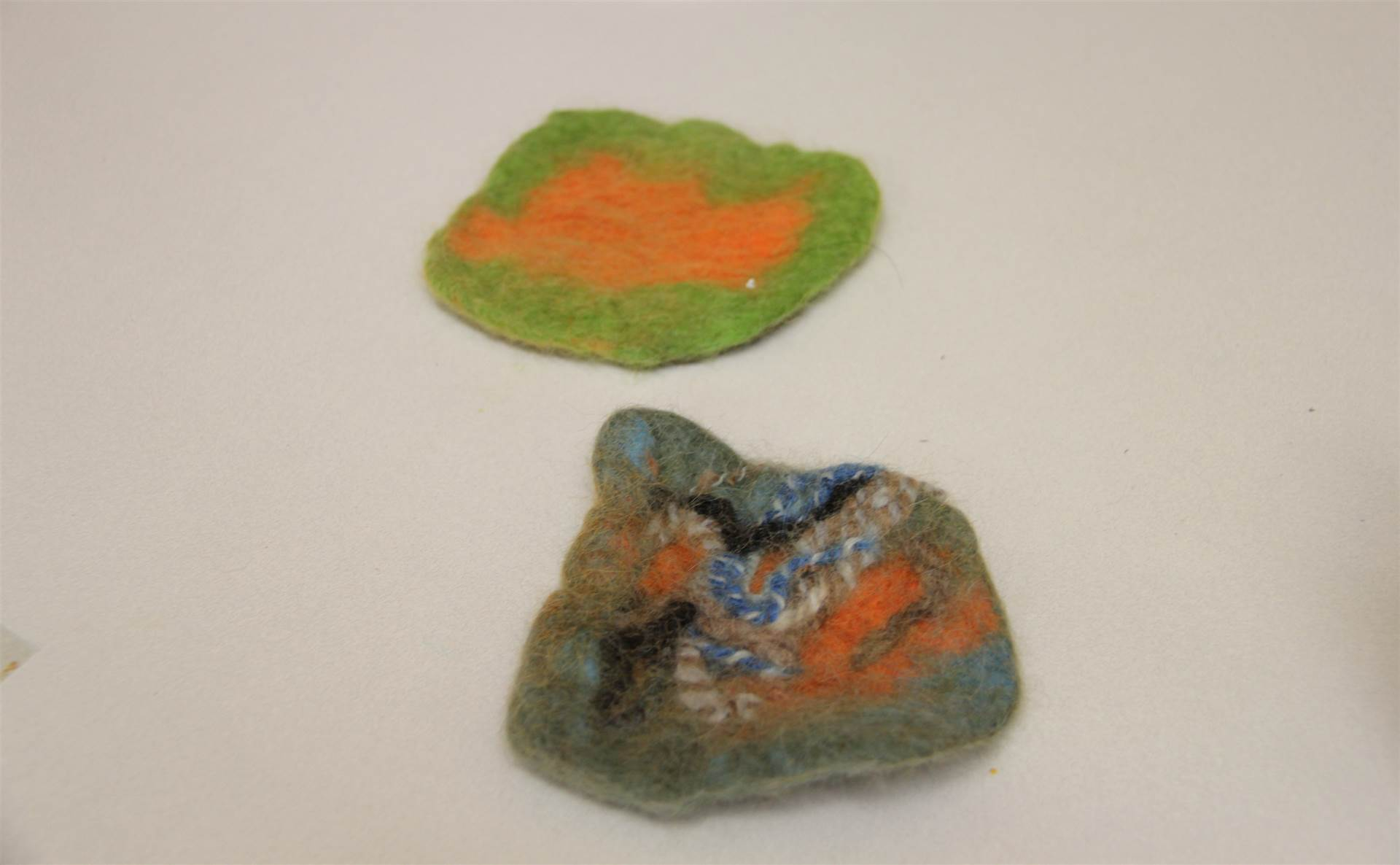 two examples of felt created by summer steam students