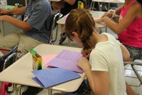 students write thank you cards to those who have provided activities in summer steam