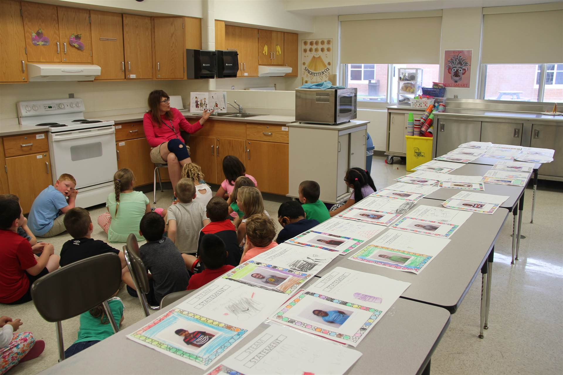 teacher reads to students in c v summer steam