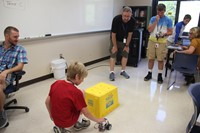 mister cass helps students test robots at boces steam