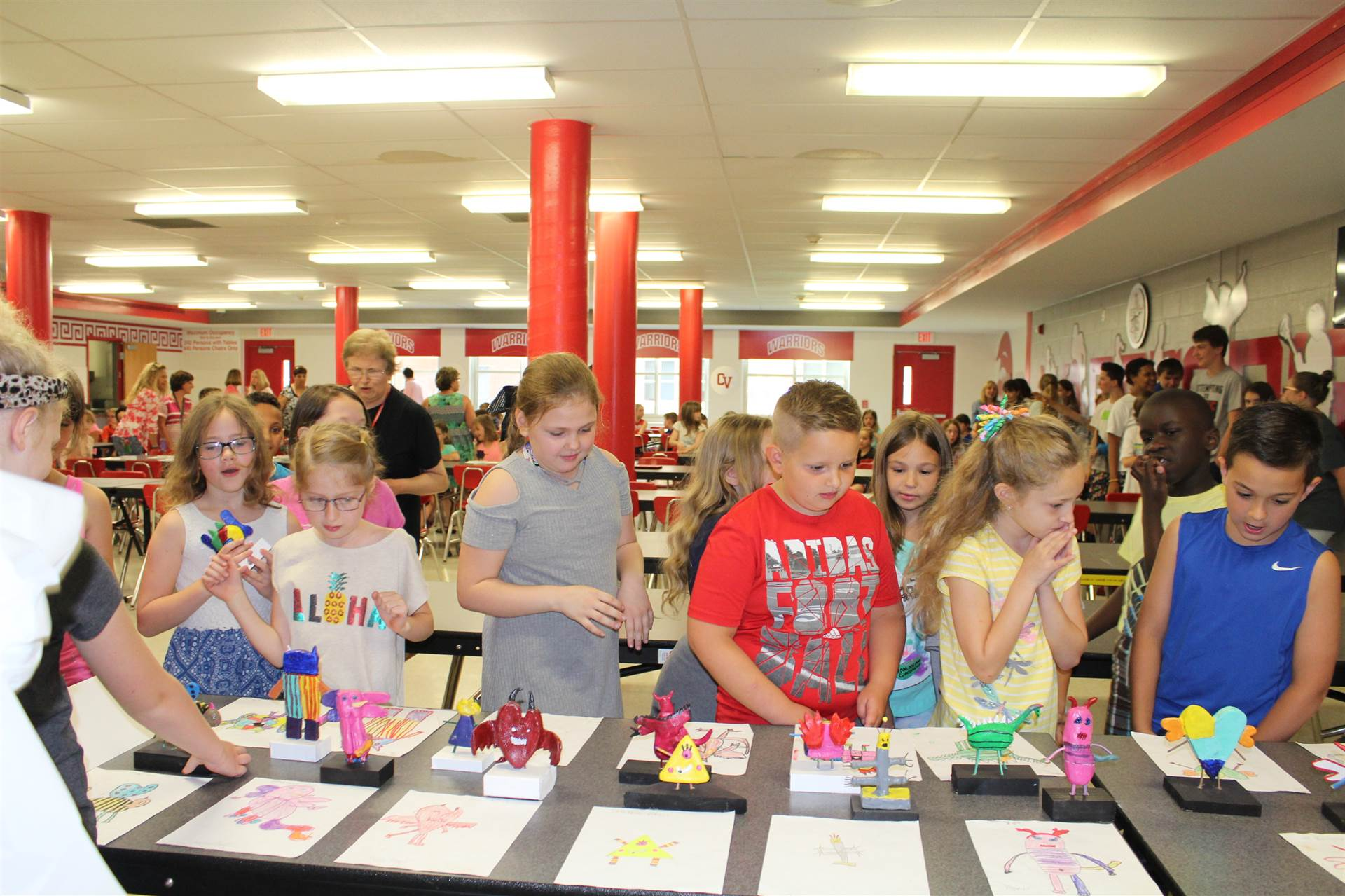 third grade students check out their new monster mash reveal creations