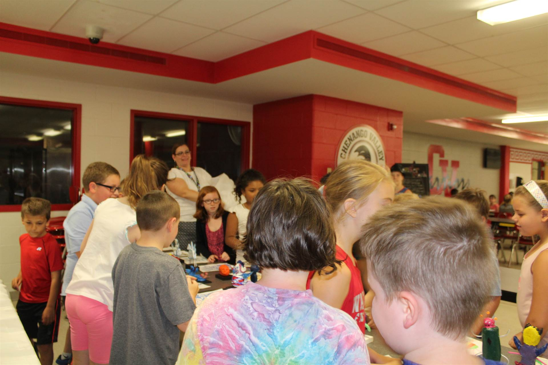 students at fifth table check out their new 3 d monster sculptures