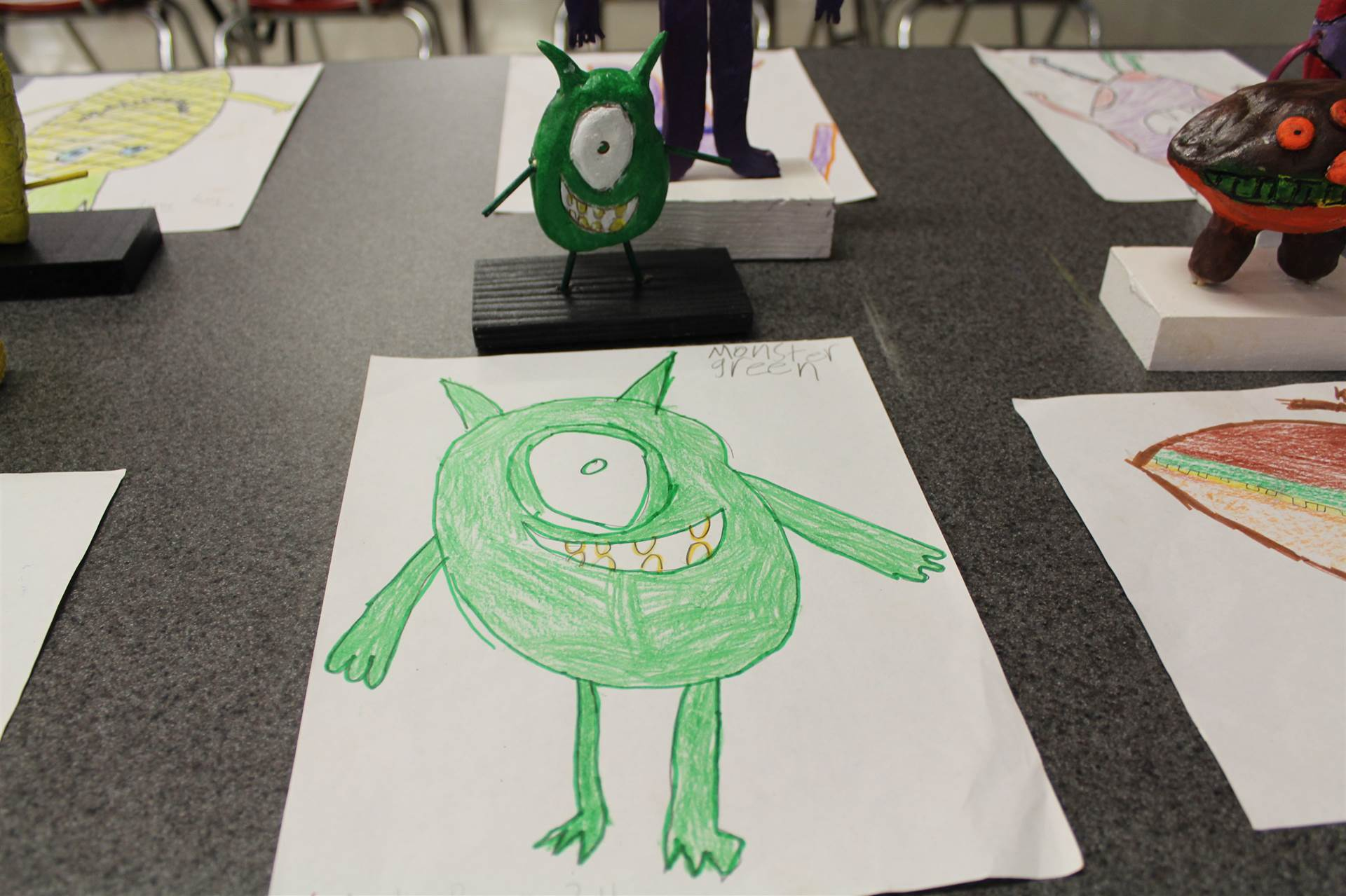monster 3 d sculpture next to drawn picture 77