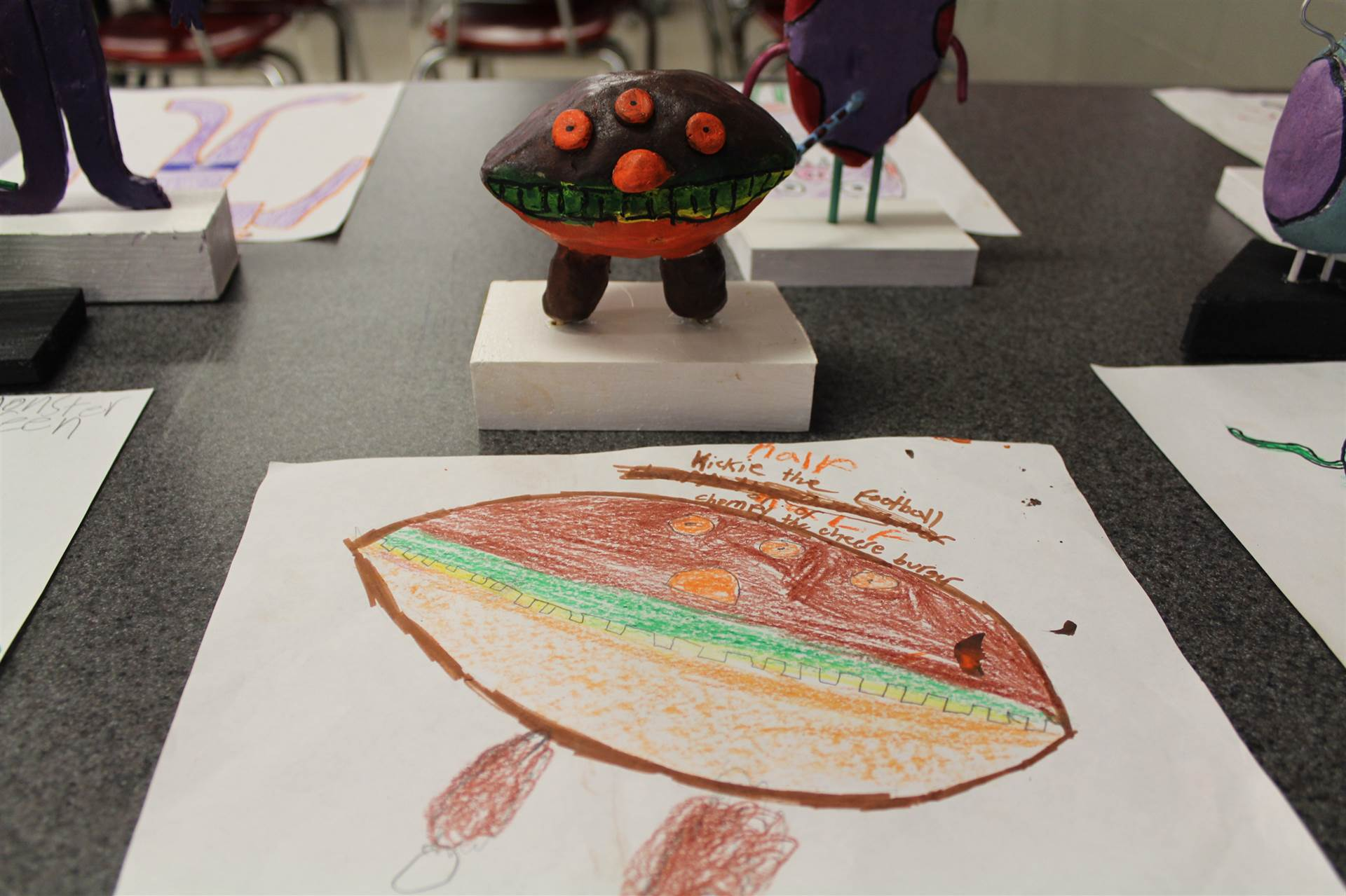 monster 3 d sculpture next to drawn picture 76