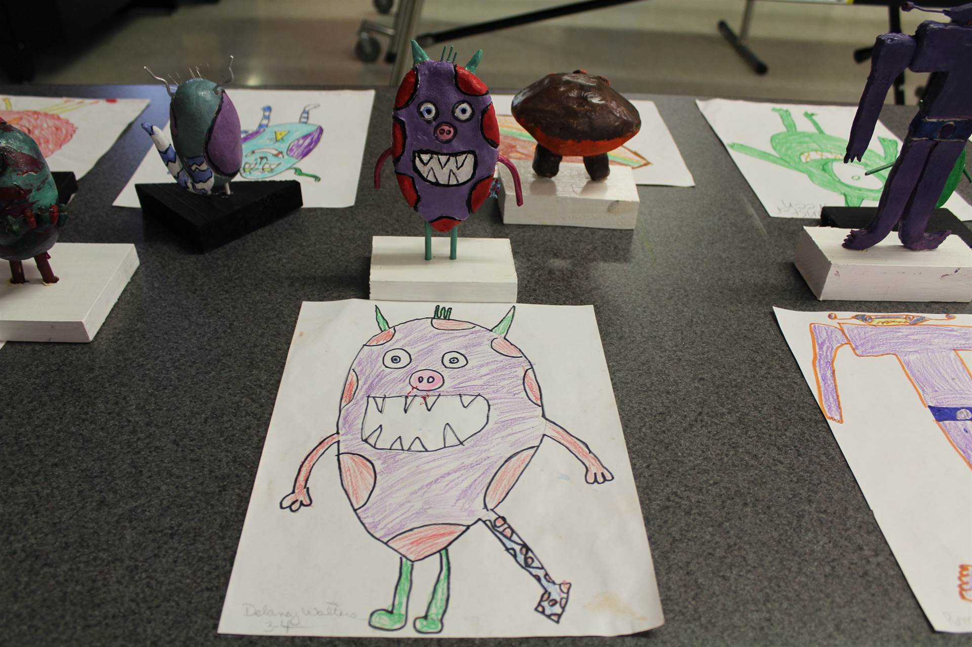monster 3 d sculpture next to drawn picture 72
