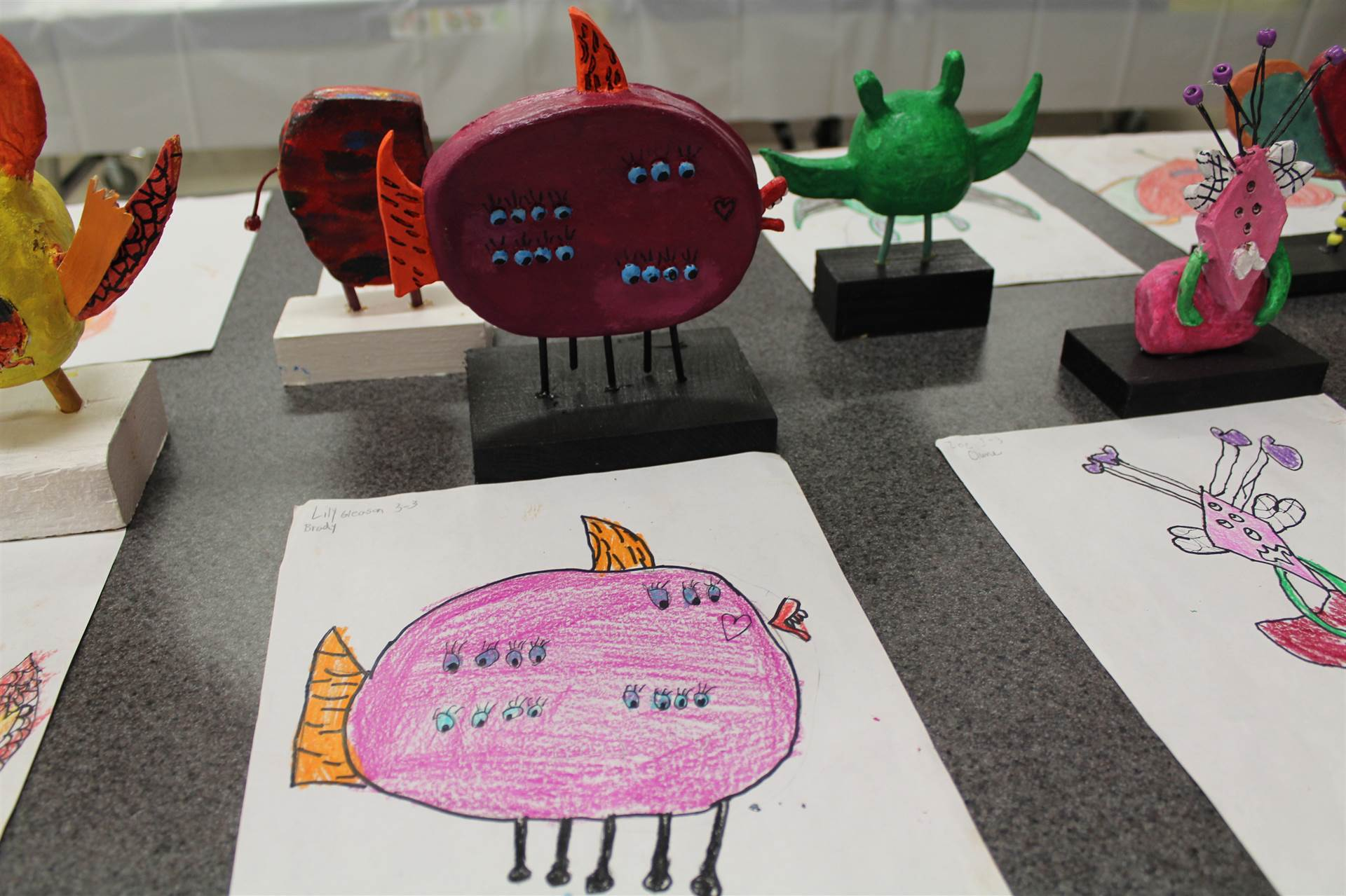 monster 3 d sculpture next to drawn picture 55