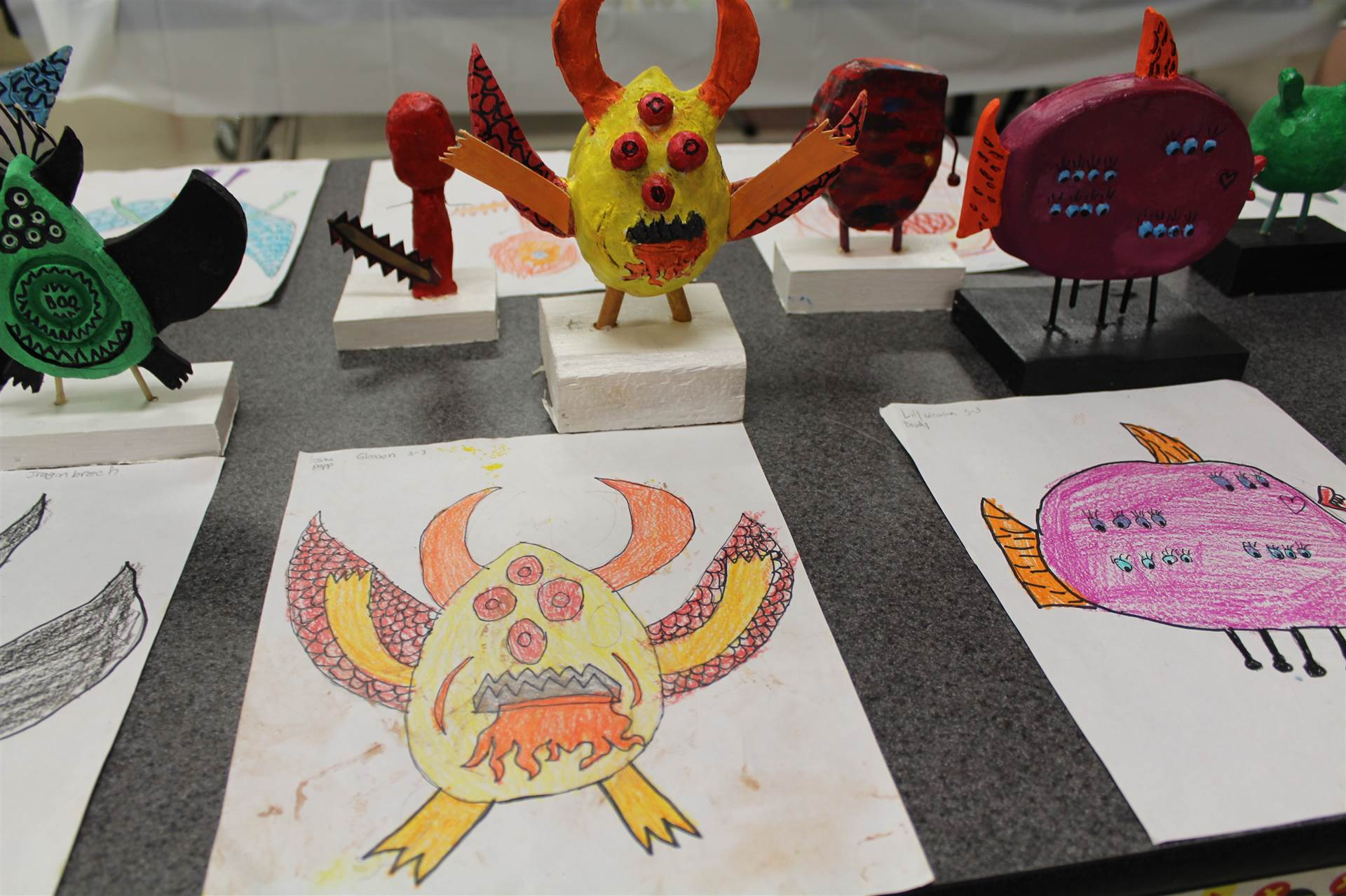 monster 3 d sculpture next to drawn picture 54